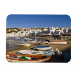 The harbor town with colorful fishing boats magnet