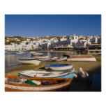 The harbor town with colorful fishing boats posters