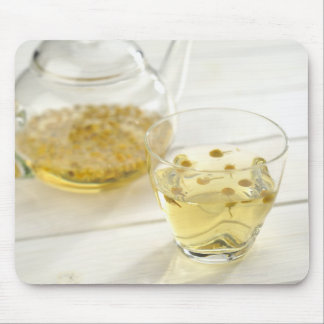 The herb tea which a glass teapot and a cup mouse pad