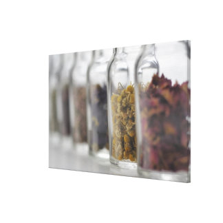 The herbs which a glass bottle contains canvas print