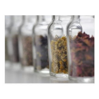 The herbs which a glass bottle contains postcard