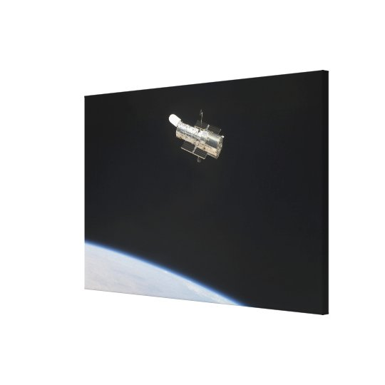 The Hubble Space Telescope in orbit above Earth 2 Canvas Print