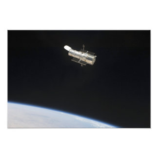 The Hubble Space Telescope in orbit above Earth 2 Photo Print