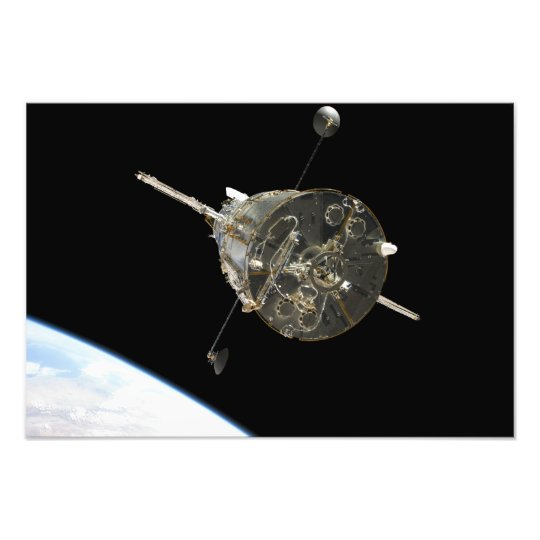 The Hubble Space Telescope in orbit above Earth Photo Print