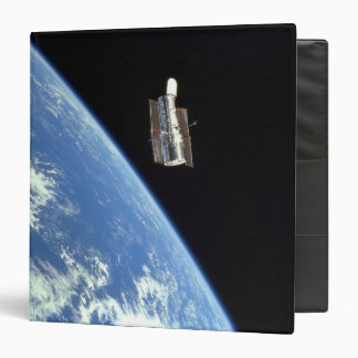 The Hubble Space Telescope with a blue earth Binder