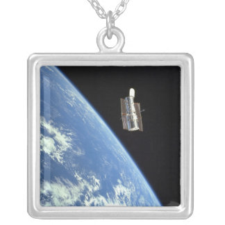The Hubble Space Telescope with a blue earth Square Pendant Necklace