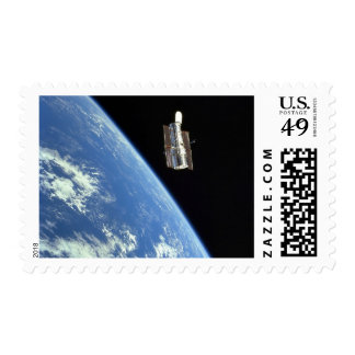 The Hubble Space Telescope with a blue earth Stamps