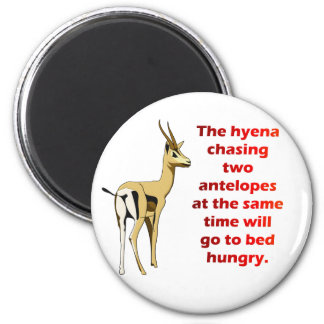 The hyena that chases 2 antelopes 2 inch round magnet