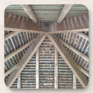 The inside of a wooden roof drink coaster