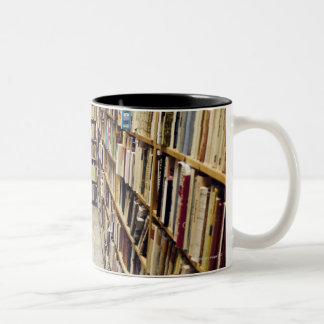 The interior of a second-hand bookshop Sweden. Two-Tone Coffee Mug