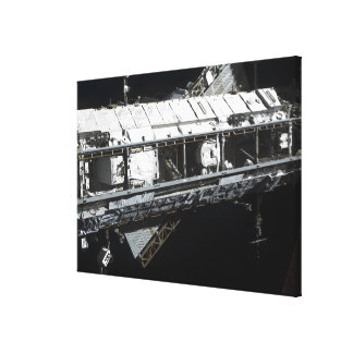 The International Space Station's starboard tru Canvas Print