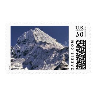 The jagged peaks of Tamserku, at 21,680 ft., jut Postage