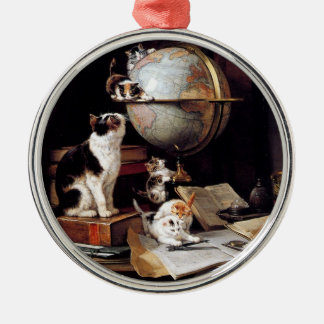 The kitten which plays in the globe metal ornament