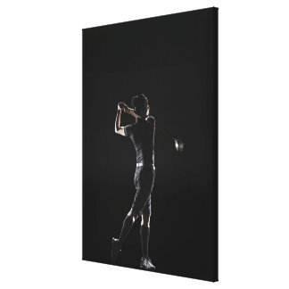 The lady golfer swings the driver of golf canvas print
