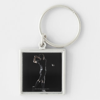 The lady golfer swings the driver of golf keychain