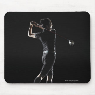 The lady golfer swings the driver of golf mouse pads