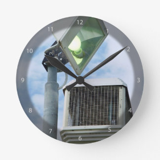 The Lesser Great Bug Zapper against sky Round Wall Clock