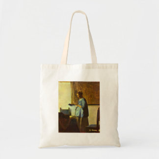 The letter reader by Johannes Vermeer Tote Bags