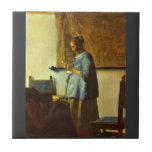 The letter reader by Johannes Vermeer Ceramic Tile