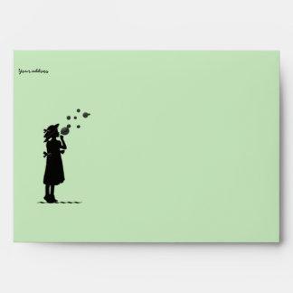 the little girl blowing soap bubbles envelope