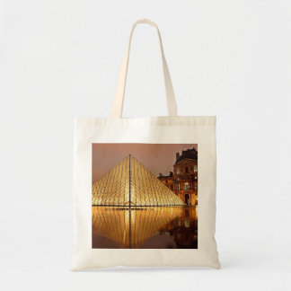 The Louvre Pyramid in the courtyard of the Louvre Tote Bag