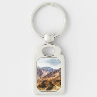 The lower hills of the might Himalayas Keychain