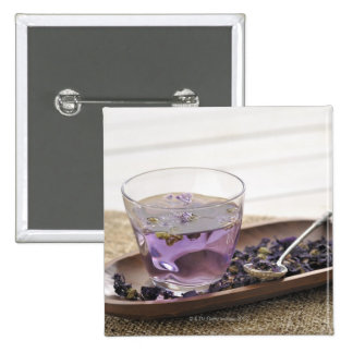 The mallow herb tea which a glass cup contains, pinback buttons