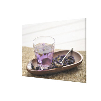 The mallow herb tea which a glass cup contains, canvas print