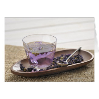The mallow herb tea which a glass cup contains, card
