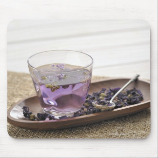 The mallow herb tea which a glass cup contains, mouse pad