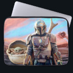 """The Mandalorian And The Child At Sunset Laptop Sleeve<br><div class=""""desc"""">Get ready to join Mando and The Child as they journey throughout the galaxy aboard the Razor Crest. Taking on many challenges along the way and meeting an array of different characters, this is the dream team to have on your side on any intergalactic mission. This classic image can be...</div>"""