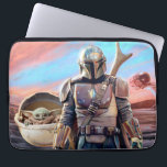 "The Mandalorian And The Child At Sunset Laptop Sleeve<br><div class=""desc"">Get ready to join Mando and The Child as they journey throughout the galaxy aboard the Razor Crest. Taking on many challenges along the way and meeting an array of different characters, this is the dream team to have on your side on any intergalactic mission. This classic image can be...</div>"