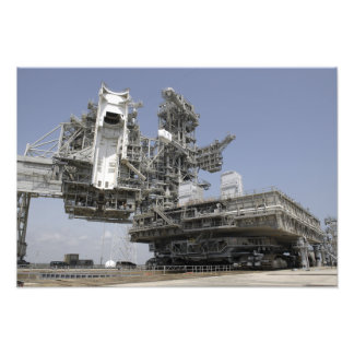 The mobile launcher platform is being moved photographic print