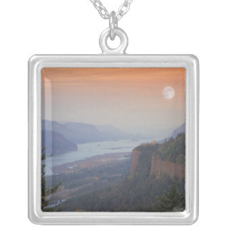 The moon hangs in the sky above the Vista Custom Jewelry