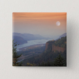 The moon hangs in the sky above the Vista Pinback Button