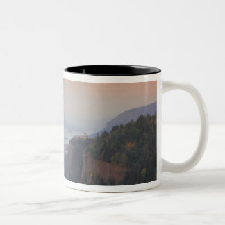The moon hangs in the sky above the Vista Two-Tone Coffee Mug