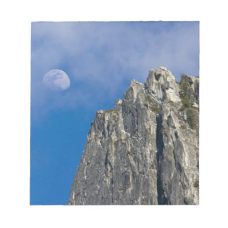 The moon rises and shines through the clouds notepad