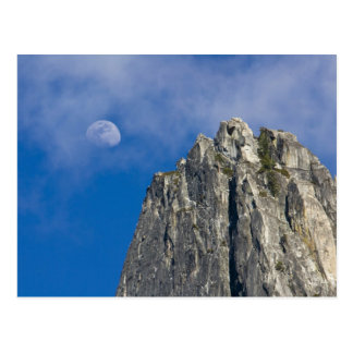 The moon rises and shines through the clouds postcards