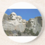 """The Mount Rushmore Presidential Monument Sandstone Coaster<br><div class=""""desc"""">The Mount Rushmore Monument as seen from the viewing plaza. Sign up to Mr. Rebates for FREE and save 12% on any zazzle order in addition to a $5.00 sign up bonus All Rights Reserved; without: prejudice, recourse or notice (U.C.C. 1-308) http://en.wikipedia.org/wiki/File:Dean_Franklin_-_06.04.03_Mount_Rushmore_Monument_(by-sa)-3_new.jpg &quot;mount rushmore&quot; &quot;mt. rushmore&quot; monument president washington lincoln...</div>"""