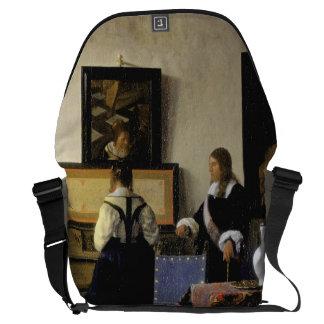 The Music Lesson by Johannes Vermeer Messenger Bag