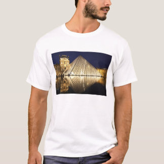 The night view of the glass Pyramid of Musee du T-Shirt