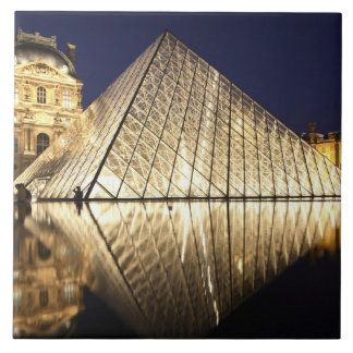 The night view of the glass Pyramid of Musee du Large Square Tile