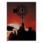 The old windmill at sunset post card