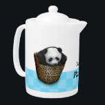 "The panda cub plays with a basket teapot<br><div class=""desc"">Fluffy panda cub trying to tumble out of baskets and play hide-and-seek with it"