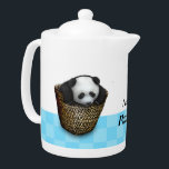 """The panda cub plays with a basket teapot<br><div class=""""desc"""">Fluffy panda cub trying to tumble out of baskets and play hide-and-seek with it"""