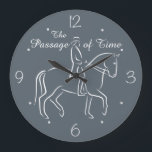 """The passage of time dressage large clock<br><div class=""""desc"""">A play on words for dressage enthusiasts with the stylized white outline of a horse and rider performing a passage,  piaffe,  or collected trot,  with the words The Passage of Time in white script,  and a white clockface with numbers and dots</div>"""