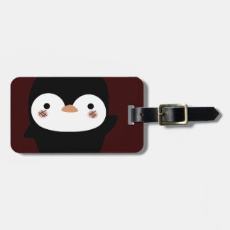 the penguin luggage tag