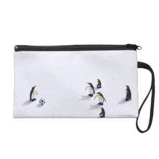 The penguins playing soccer wristlet purse