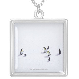 The penguins playing soccer silver plated necklace