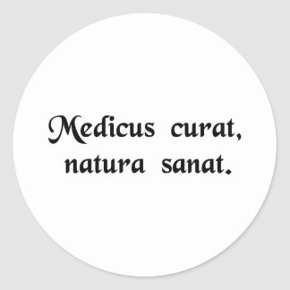 The physician treats, nature cures. classic round sticker